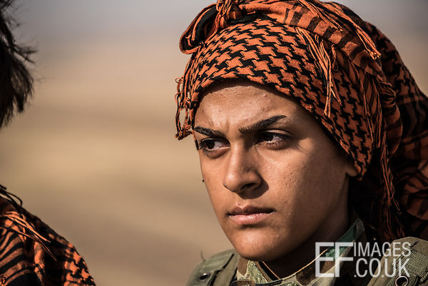 PAK (Kurdistan Freedom Party) female fighter at her base north of Hawija, where Kurdish Iranian fighters are holding the line...