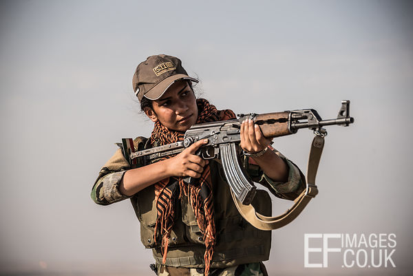 PAK (Kurdistan Freedom Party) female fighter during a training session at her base north of Hawija, where Kurdish Iranian fig...
