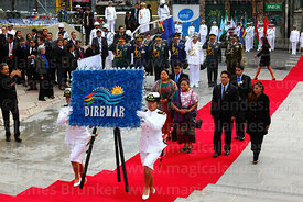 Guatemalan indigenous rights activist Rigoberta Menchú accompanies members of DIREMAR as they present a floral tribute at the...
