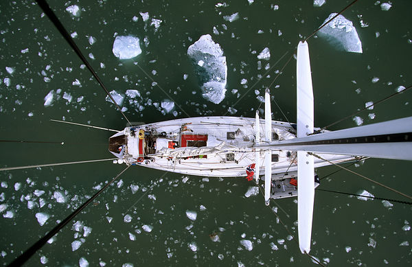View of sailboat from directly above, showing  deck, and floating ice. King's Bay, Spizbergen, Svalbard Archipelago, Norway, ...