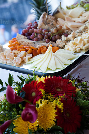 Flower bouquet in front of cheese platter