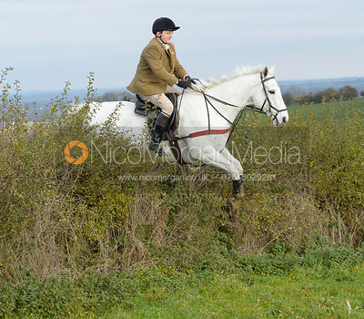 Billy Chatterton jumping a hedge near Clawson Thorns