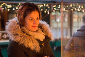 Young Woman Gazing at items in the Rathausmarkt Christmas Market