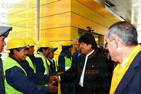 Bolivian president Evo Morales (centre) greets Mi Teleferico company workers as he arrives for the opening ceremony of the Ye...
