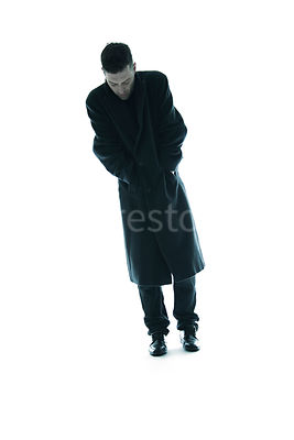 A mystery man, walking in a big coat – shot from low level.