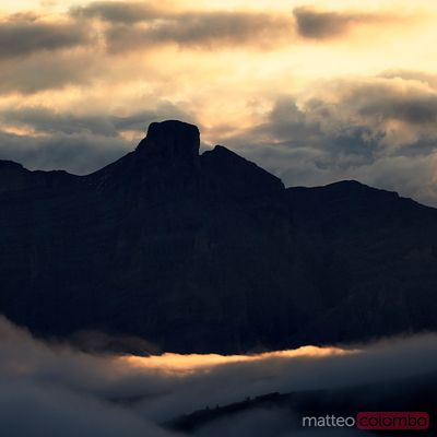 Dramatic light over La varella peak in the Dolomites at sunrise