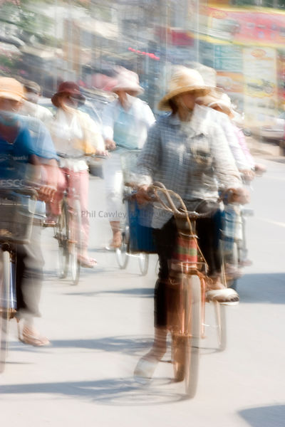 Cyclists commuting in Siem Reap, Cambodia