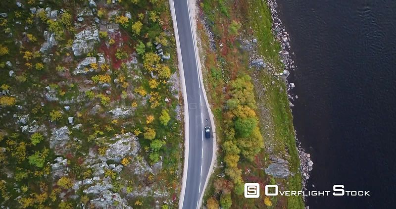 Autumn Color Road, Aerial Tilt View of a Car Parked on 970 the Tenontie Road Full of Different Colors, Near Tenojoki River, o...