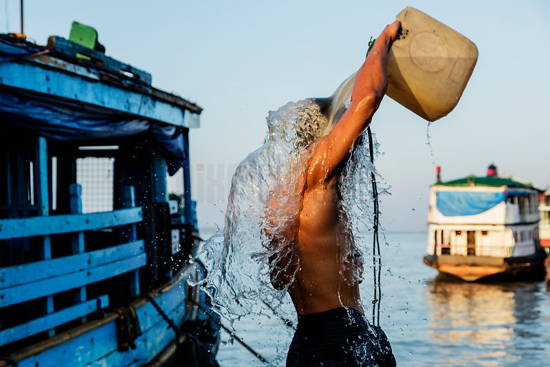Boat Worker Taking a Morning Shower
