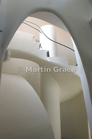 Staircase in attic of Gaudi-designed Casa Batllo apartment building in Barcelona, plastered and white-painted