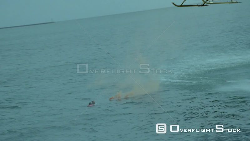 Aerial of a paramedic rescuing a man in the sea while a rescue helicopter hovers above Cape Town Western Cape South Africa