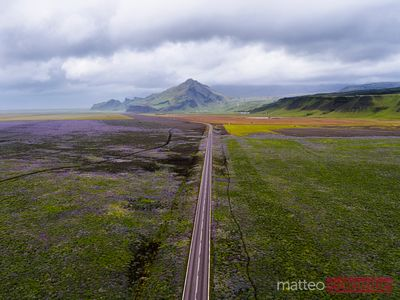 Aerial drone view of road and mountains in south Iceland