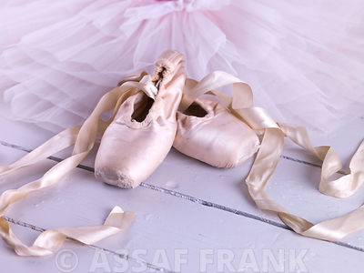 Ballet shoes and elegant ballet skirt on floor