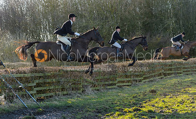 Geoff Bridges jumping a hedge at Town Park Farm - The Cottesmore at Town Park Farm