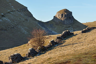 Blue sky in Cressbrook Dale with Peter's Stone