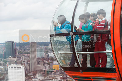 Oriental tourists take photographs from London Eye pod