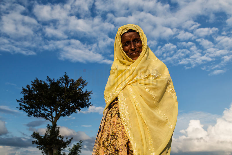 Woman in Yellow Sari against the Sky