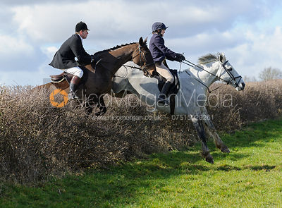 Alice Gibb jumping a hedge behind Ladywood Lodge