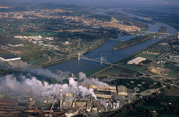 Aerial view of River Rhone at Beaucaire with pollution from factory producing paper paste, Camargue, France