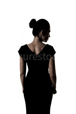 A woman standing, in semi-silhouette – shot from mid level.