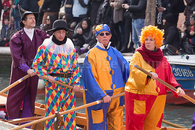 People in the Venice Carnival Opening Water Parade wearing Jester and traditional Clown Costumes