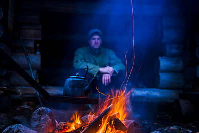 By the fire in the lean-to shelter