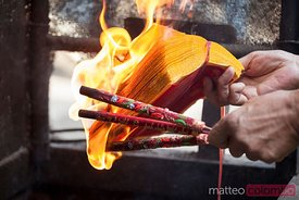 Burning incense sticks in a buddhist temple, China