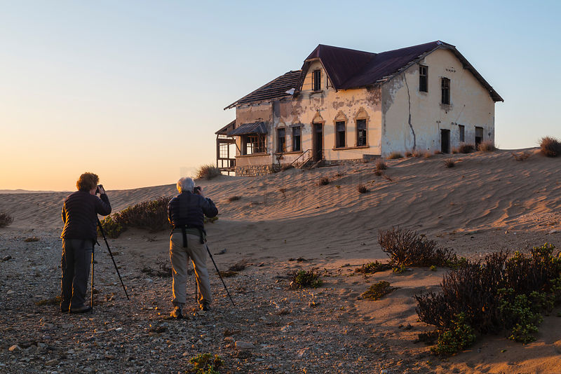 Photographers Taking Pictures at Ghost Town at Dawn