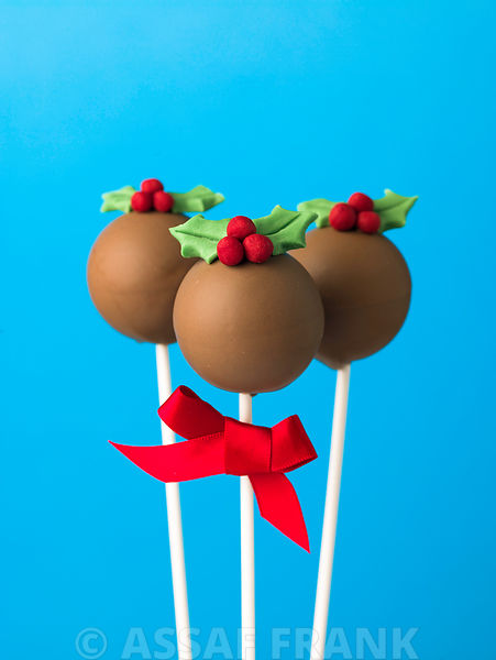Group of three christmas pudding pop cakes