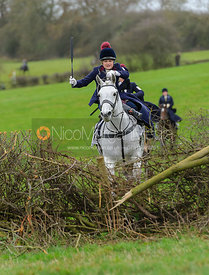 Steph Hensman and MARLEY jump the last hedge in the Dianas of the Chase Cup
