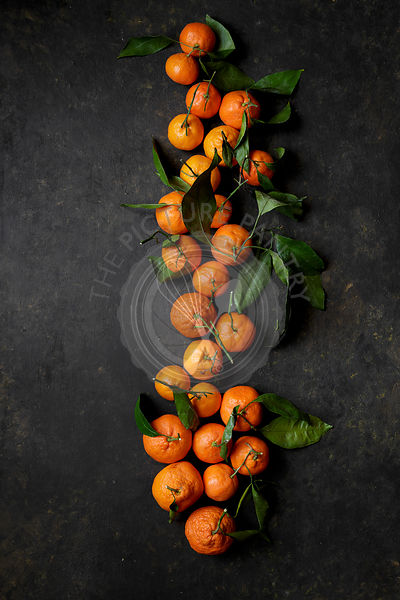 Clementine oranges on a black background