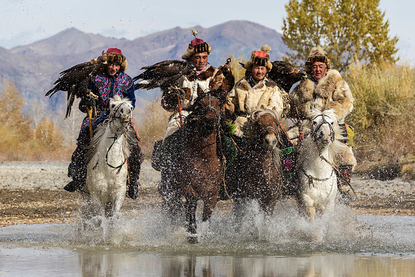 Eagle Hunters Crossing Small Pond on Horseback