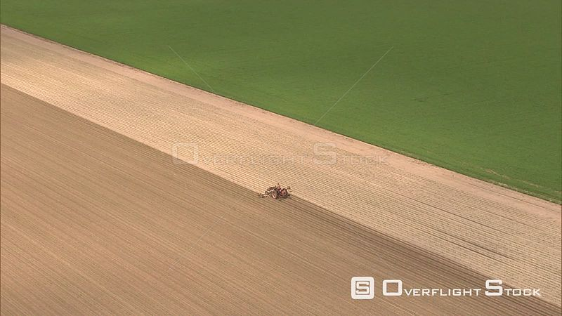 Tractor tilling a field in the Flevopolder, The Netherlands