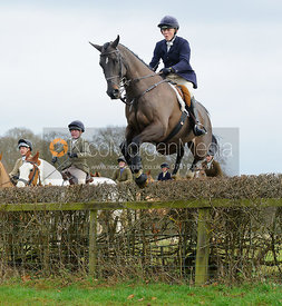 Caroline Edwards jumping a hedge at Goadby Hall - The Belvoir Hunt at Goadby Hall 24/12