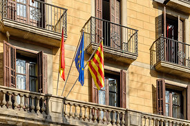 Flags of European Union, Spain and Catalonia outside a building in Barcelona.