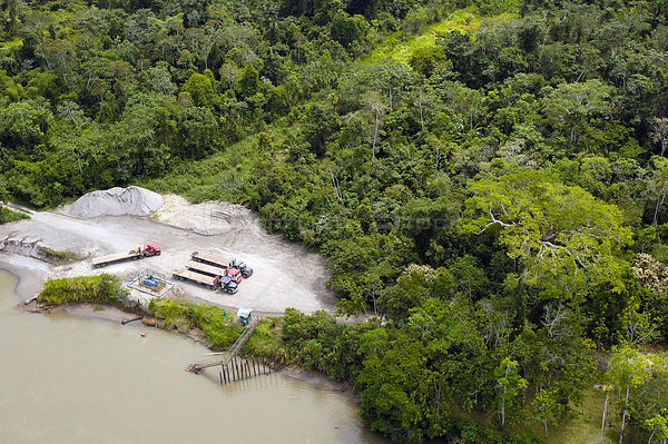 Trucks coming from either Coca or Lago Agrio cross the Napo river by barge before travelling on to various oil company instal...