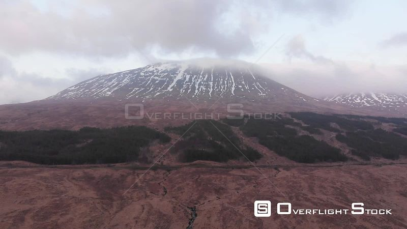 Aerial drone shot of a mountain in West Highlands of Scotland