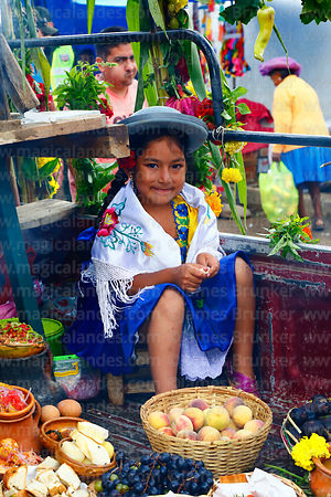 Girl with typical local produce in back of a pick up truck during Carnival parades, San Lorenzo, Tarija Department, Bolivia