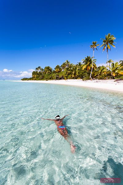 Woman snorkeling in Aitutaki, Cook Islands