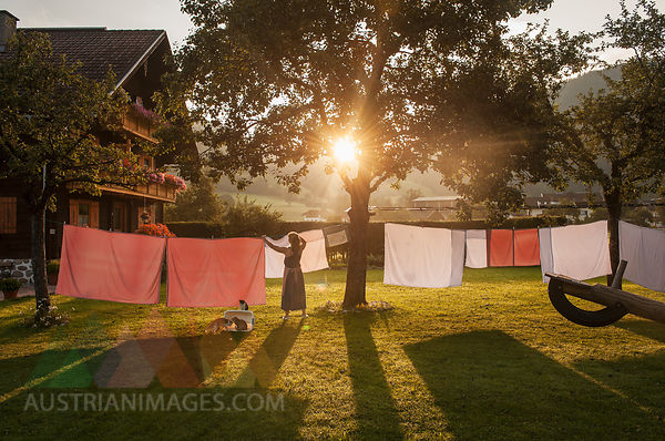 Austria, Radstadt, Farm, Female farmer hangs the washing on the line
