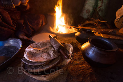 A woman from the Cheeta caste prepares Chapati bread from wheat grown only five minutes away, Kharekhari village, Rajasthan, ...