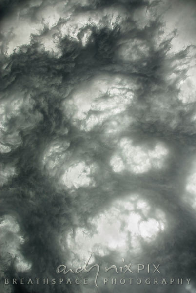 Abstract of strange dark storm clouds forming rings of light patches