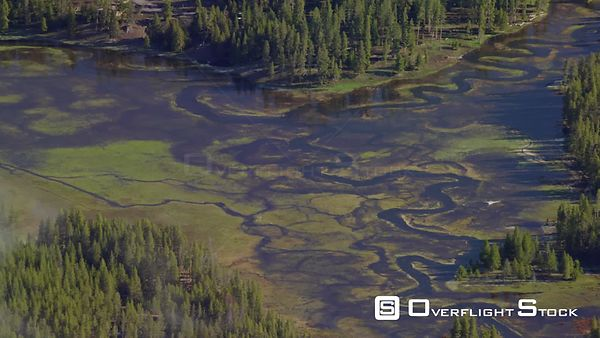 A winding river and low hanging cloutds in Yellowstone National Park