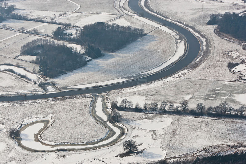 Aerial view of River Aller, in winter snow covered landscape, Lower Saxony, Germany, February 2012