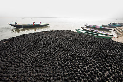 Animal dung (cow or water buffalo) patties dry on the ghats of Varanasi, India. They will be used for fuel for cooking and wa...