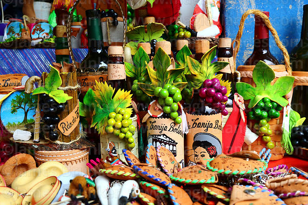 Leather and ceramic wine bottle holders, purses and other items for sale in souvenir shop, Tarija, Bolivia