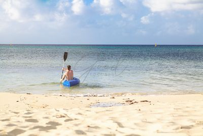 Man on Kayak on Peaceful Beach