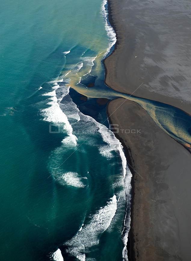 Aerial view of river and coast, South West Iceland, June 2014.