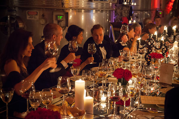Guests toast at the Raymond Vineyards dinner party at Auction Napa Valley.