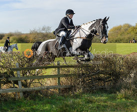 Hilary Butler jumping a fence near the Wisp
